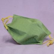Wiederverwendbare Mund- und Nasen-Behelfsmaske grün mit kleinen Punkten aus doppellagigem Baumwollstoff